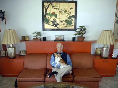 Jack Weinstein sits in his Asian inspired livingroom with his dog DJ. (Ron Tarver / Staff Photographer)
