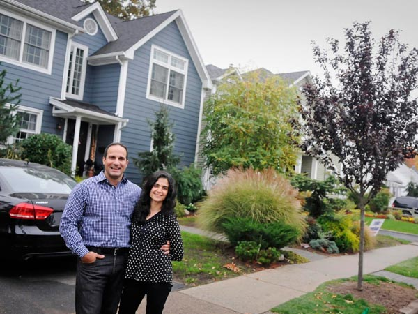 Dean and Tina Mastrojohn, right, stand in front of their Maywood, N.J. home. He´s originally from Dumont and always liked living in a small town with a neighborhood. They bought in Maywood nine years ago for the same small-town feel but also because of its close proximity to highways and convenience to New York. (Carmine Galasso/The Record/MCT)
