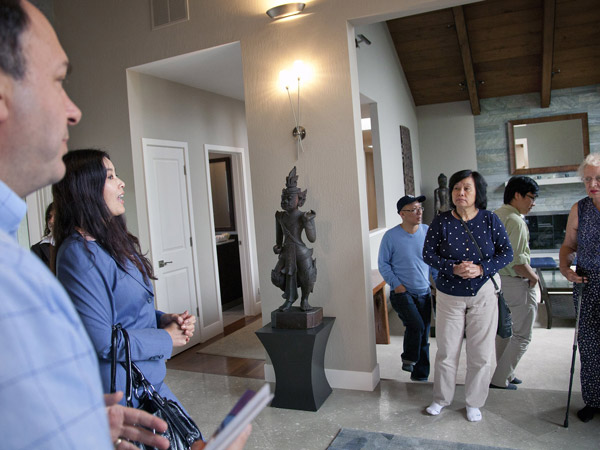 DeLeon Realty Director of Asian Operations Kim Heng, second from left, addresses potential buyers during a tour of a house in Los Altos Hills by DeLeon Realty, for visiting Chinese buyers, September 21, 2013. (LiPo Ching/Bay Area News Group/MCT)