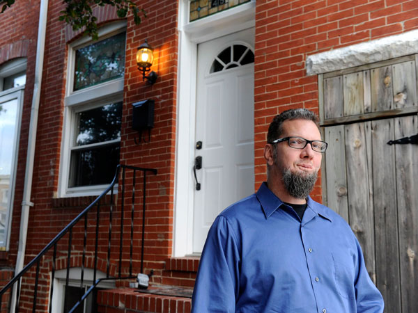 Chris Benedetti at his former home in Baltimore, Maryland. He priced it to sell quickly and it did. (Colby Ware/Baltimore Sun/MCT)