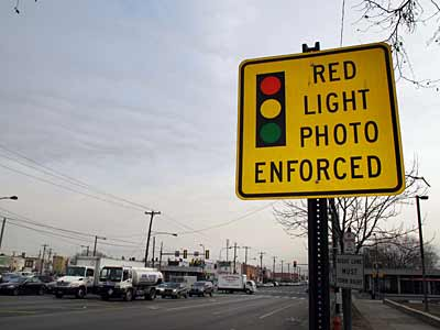 A sign warns motorists about a red light camera system at Broad Street and Oregon Avenue in Philadelphia. (Laurence Kesterson / Staff Photographer / File)