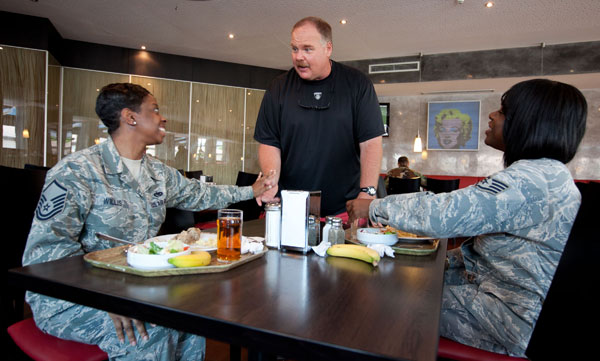 Eagles head coach Andy Reid visits with service members at a dining facility at Ramstein Air Base in Germany.