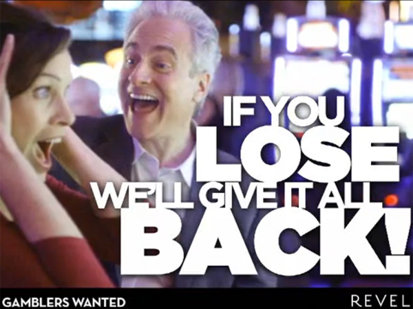 A scene from a Revel Casino-Hotel commercial about a July 2013 promotion that returns lost slot bets totaling $100 to $100,000 not in cash but in the form of future slot play.