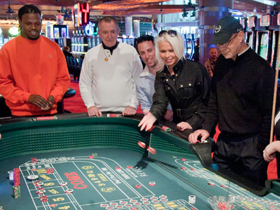 Julie Radyn, 29, and her friend Samuel Lassoff, 32, both of Northeast Philadelphia, try their luck at a craps table of the new Revel Casino and Resort in Atlanta City Monday, April 2, 2012.  The doors opened at 7 a.m. to gamblers at the start of an 8-week preview before the official grand opening Memorial Day Weekend.  ( Clem Murray / Staff Photographer )