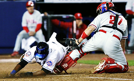 Jose Reyes is ruled safe at a play at the plate in last night's 4-3 victory over the Phillies.