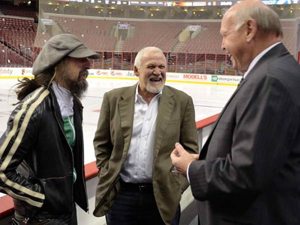 "Director and rock musician Rob Zombie does some ""fact-finding"" with two of the Broad Street Bullies, Bernie Parent (center) and Bob Kelly. (ZACK HILL)"