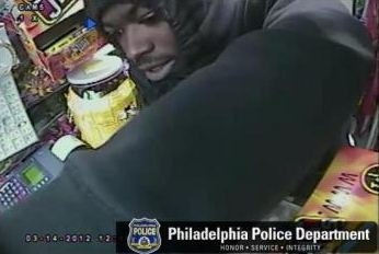 Unknown armed robber wanted in grocery store stickup