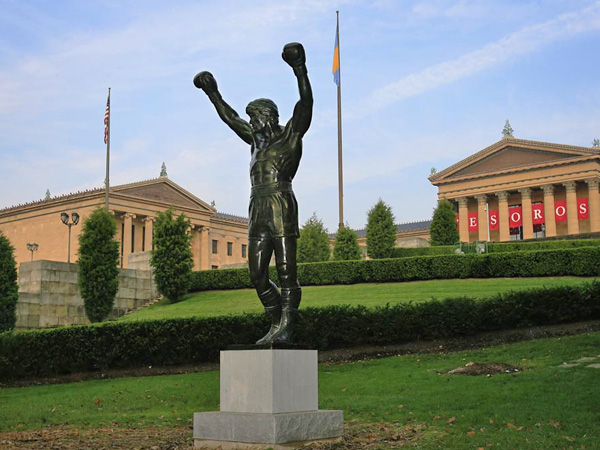 "The bronze statue of Sylvester Stallone portraying the boxer in the film ""Rocky III"" is seen near the steps of the Philadelphia Museum of Art in Philadelphia.  (AP Photo/Matt Rourke)"