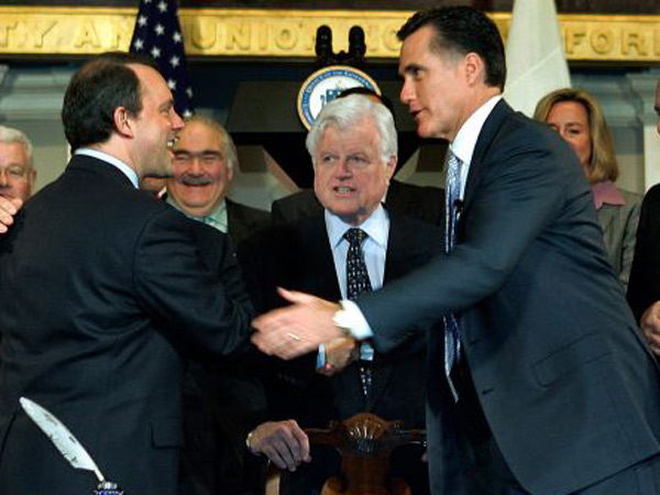Massachusetts Gov. Mitt Romney, right, shakes hands with Massachusetts Health and Human Services Secretary Timothy Murphy after signing into law a landmark bill designed to guarantee that virtually all Massachusetts residents have health insurance. AP