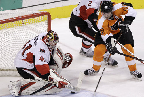 Briere scores the game-winner Saturday ( AP / Matt Slocum )
