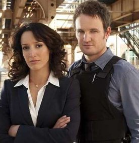 "Jennifer Beals and Jason Clarke in ""The Chicago Code."""