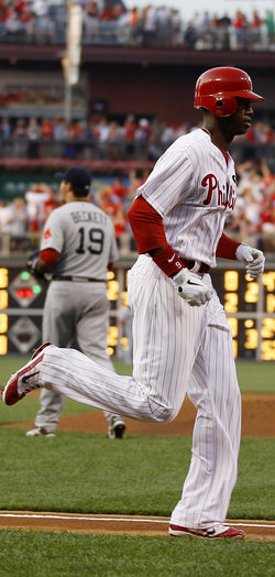 Domonic Brown rounds third base after his two-run home run Tuesday (AP/Matt Slocum)
