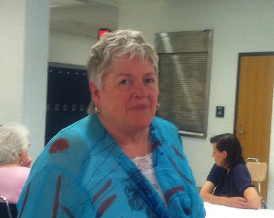 Sharon Parker makes the rounds at a community breakfast at the high school.