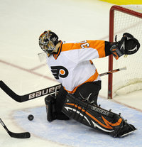 Bryzgalov makes a save Sunday ( AP Photo ).