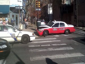 A minivan rammed a taxi after running a red light - and then it kept on running.