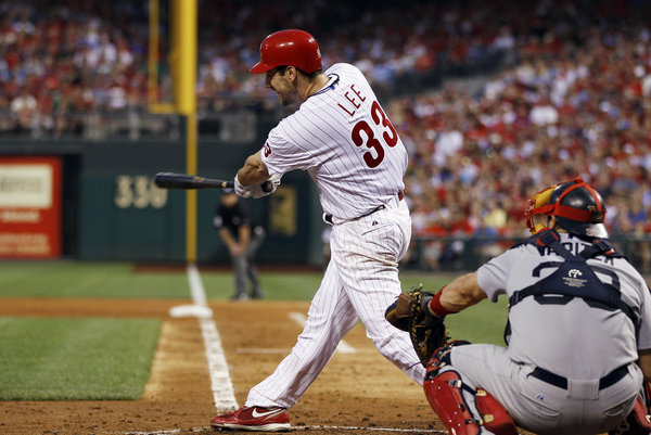 Cliff Lee hits a sacrifice fly Tuesday against the Red Sox (AP/Matt Slocum)