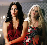 "Courteney Cox (left) and co-star Busy Phillipps in ""Cougartown."""