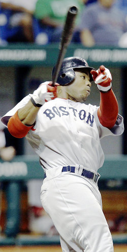 Red Sox´s Carl Crawford bats on the day before be pulled a hamstring earlier this month (AP/Chris O´Meara)