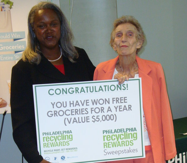 Streets Commissioner Clarena I.W. Tolson (left) and sweepstakes winner Eva Basiura at the sweepstakes announcement. (Streets Department photo)