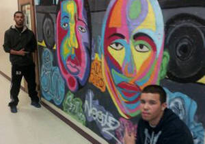 Two artistic students, Magdiel S. and Luis N. from Camden Academy Charter High School, display their painting of hip-hop lends in the main hallway for all to see.