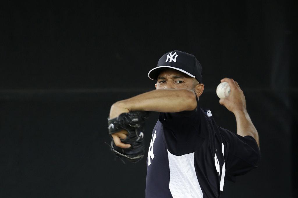 Yankees closer Mariano Rivera will not say whether he will play beyond this season. (Matt Slocum / AP)