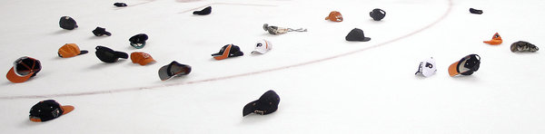 Hats line the ice after Hartnell´s hat trick Sunday (Yong Kim / Staff Photographer)
