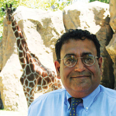 Vikkram Dewan, with Gus the giraffe in the background.