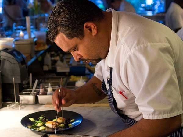 Kevin Sbraga plates a dish at the Food & Wine reception.