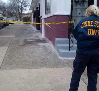 Police investigators at the scene of the shooting. (Staff photo/Bob Moran)