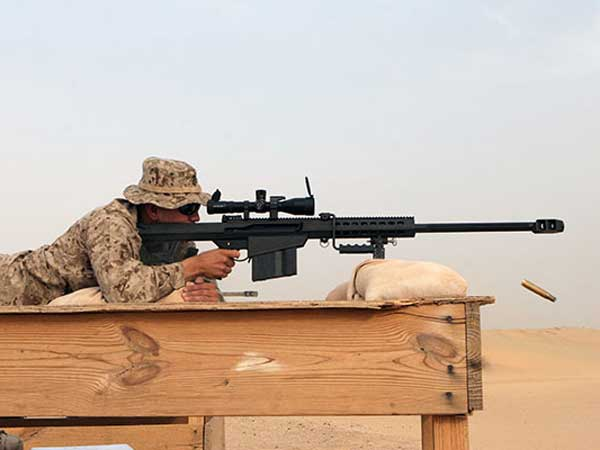 In this photo provided by the U.S. Marine Corps, a sniper fires an M107 Barrett .50 calibre rifle. Contributors who pony up $125 to the Lonegan for Senate campaign will be able to fire five rounds from an M107 during a fundraising event at the South Jersey Shooting Club in Winslow. [U.S. Marine Corps photo by Lance Cpl. Kyle J. Keathley ]