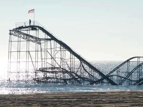 A man was arrested after climbing to the top of the partially submerged roller coaster in Seaside Heights, NJ to plant an American flag. (Posted by Twitter user @SJBroadway84)