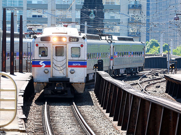 A SEPTA Trenon Line train pulls onto track four at 30th Street Station Sunday June 15, 2014. ( DAVID SWANSON / Staff Photographer )