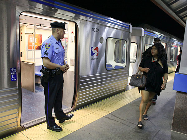 Transit police look on as passengers exit the train at the Frankford Transportation Center during the first night of SEPTA´s late night subway service in Philadelphia, Saturday June 14, 2014.  (For the Daily News/ Joseph Kaczmarek)