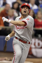 Shane Victorino screams after he gets hit in the foot by the ball during Game 3 of the National League Division Series. (Ron Cortes / Staff Photographer)