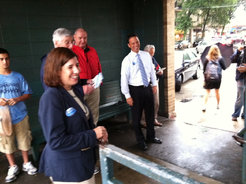 Democratic commissioner candidates Leslie Richards and Josh Shapiro greet commuters Tuesday at the Ardmore train station. JEREMY ROEBUCK/STAFF