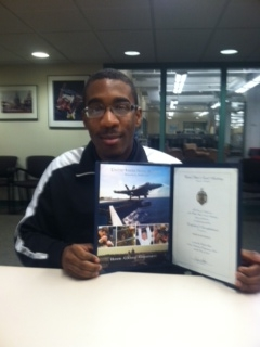 Shaquil Keels, 18, with his acceptance letter for the U.S. Naval Academy prep program.
