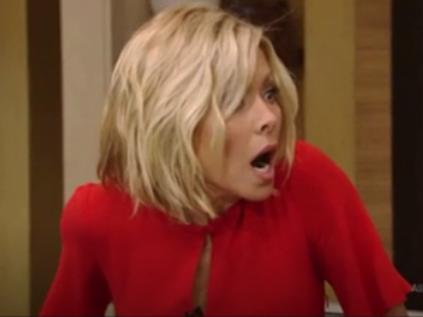 "Kelly Ripa reacts to seeing sharks invade the set of her talk show, ""Live! With Kelly and  Michael,"" during a scene from ""Sharknado 2."""