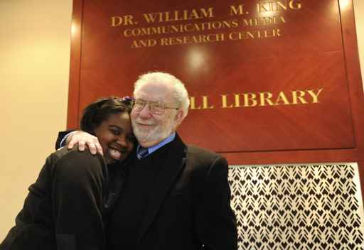 Dr. Sheldon S. Pavel, longtime president of Central High, is retiring in July.  Pavel is shown here in a file photo with a student, posing outside Central´s library.
