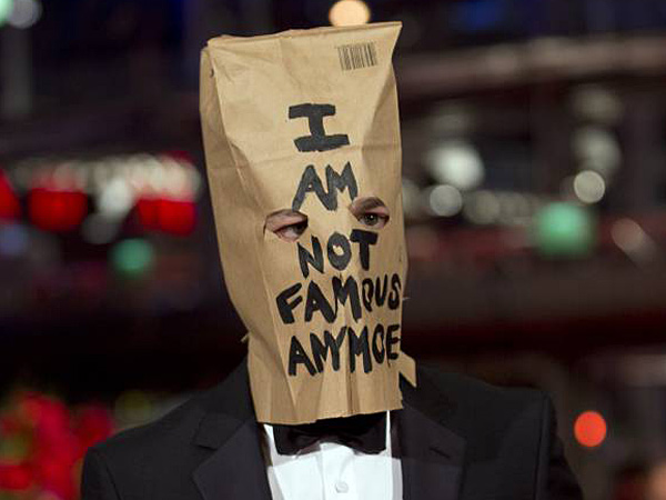 Actor Shia LaBeouf poses for photographers, with a paper bag over his head that says ´I am not famous anymore´, on the red carpet for the film Nymphomaniac at the International Film Festival Berlinale in Berlin, Sunday, Feb. 9, 2014. (AP Photo/Axel Schmidt)