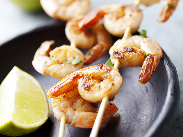 Rum-glazed grilled shrimp is a healthy alternative for your Labor Day barbecue. (istock)