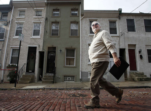 Larry Shubert, a property-tax assessor for Philadelphia, walks around the streets of Manayunk and determines home values.