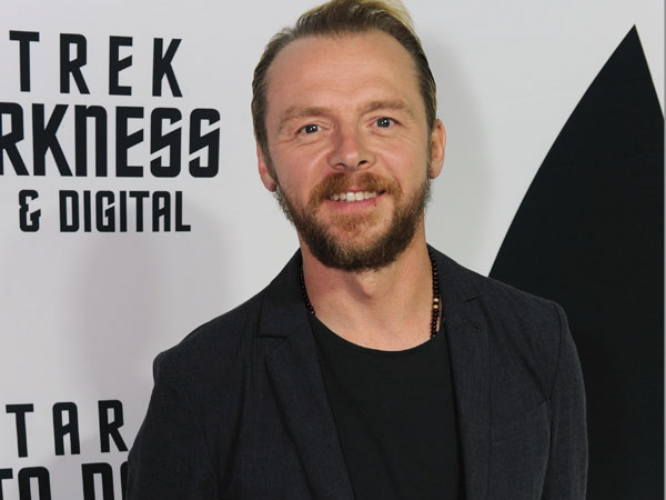 "Simon Pegg arrives on the white carpet to celebrate the home entertainment debut of the worldwide blockbuster ""Star Trek Into Darkness"" on Tuesday, Sept. 10, 2013 at the California Science Center in Los Angeles. (Photo by Jordan Strauss /Invision for Paramount Pictures /AP Images)"