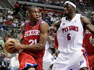 Detroit Pistons center Ben Wallace guards Philadelphia 76ers forward Thaddeus Young in the second half of an NBA basketball game. (AP Photo/Duane Burleson)