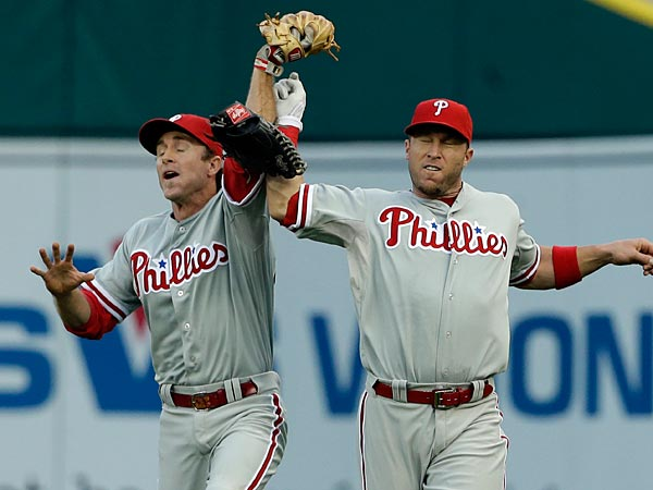 Philadelphia Phillies center fielder Michael Martinez, left, catches<br />the line drive by Detroit Tigers&acute; Victor Martinez before losing the<br />ball on an interference by teammate Jimmy Rollins, right, during the<br />first inning of a baseball game against the in Detroit, Saturday, July<br />27, 2013. (AP Photo/Carlos Osorio)