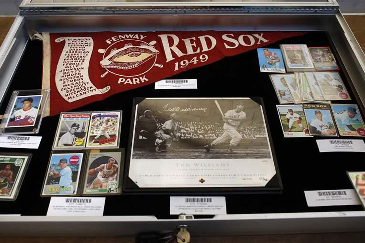 Sports memorabilia is part of an auction of abandoned safe deposit box contents conducted by the Massachusetts Treasurer's Office in 2015. State officials say residents should contact them if they think they have abandoned property and be wary of scammers who promise to reunite them with lost property for an upfront fee.
