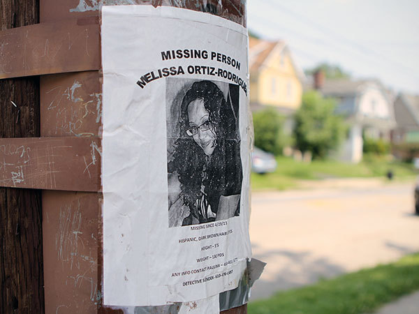 A missing poster faces the site police searched for the body of missing person Melissa Ortiz-Rodriguez, in Collingdale, on Tuesday, June 25, 2013. ( Stephanie Aaronson / Philly.com )