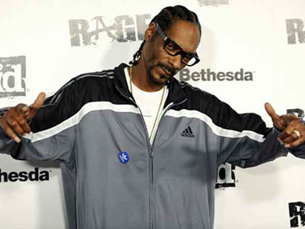 "Snoop Dogg poses at the official launch party for the video game ""Rage,"" Friday, Sept. 30, 2011, in Los Angeles. The first-person shooter video game will be released on October 4. (AP Photo/Chris Pizzello)"