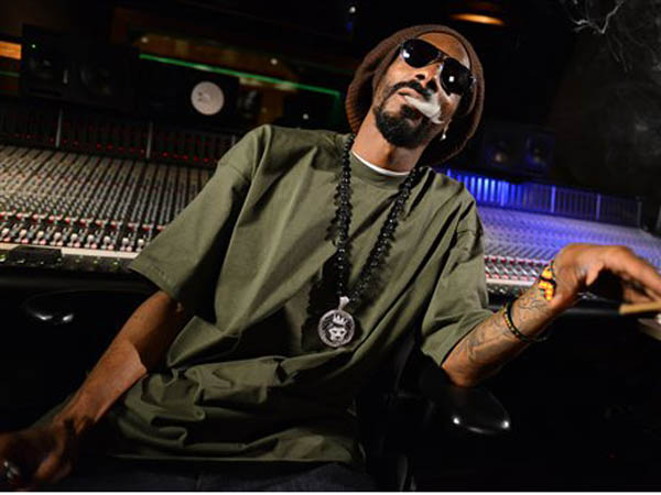 In this Tuesday, March 5, 2013 photo, Snoop Lion poses for a portrait at the Westlake Recording Studios in Los Angeles.  How committed is Snoop Dogg to his new moniker Snoop Lion? He is using the name to release a reggae- and dancehall-focused album releasing on April 23, 2013. (Photo by Jordan Strauss/Invision/AP)