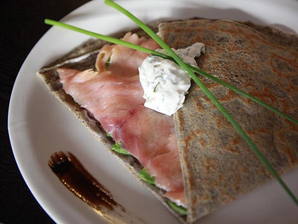 "The ""So Smoked"" crepe is composed of salmon, avocado, sour cream and chives. (Hillary Petrozziello / Staff Photographer)"