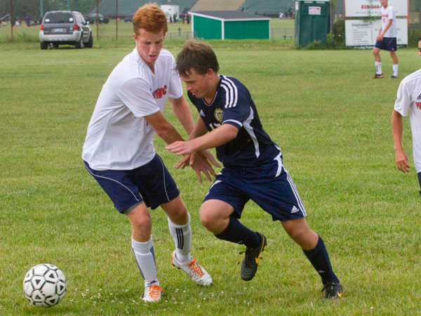 n this Tuesday, Aug. 27, 2013, photo, Flint Powers Catholic defender Connor Macksood battles for the ball with Detroit Country Day´s Alex Manning during a high school soccer match at Flint Powers Catholic soccer field in Flint, Mich. Detroit Country Day defeated Flint Powers Catholic, 1-0. (AP Photo/MLive.com, Michelle Tessier )
